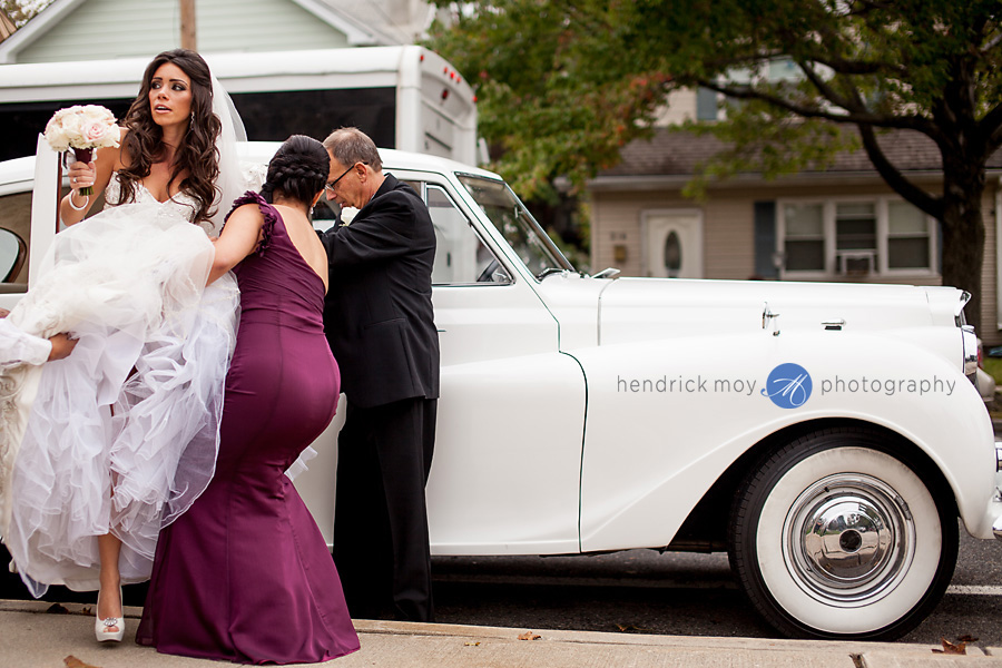 bride out of classic limo hendrick moy photography