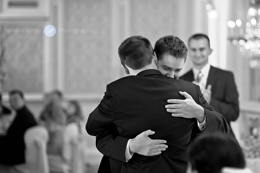 Tides Estate NJ Wedding pictures best man hug