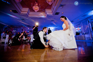 Tides Estate NJ Wedding pictures groom getting garter