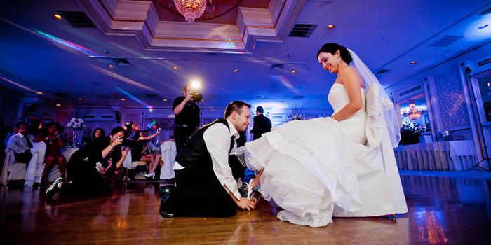 Tides Estate NJ Wedding pictures groom getting garter