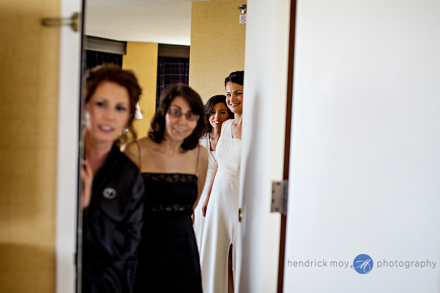 Meadowlands-Sheraton-NJ-Wedding-Photographer-Hendrick-Moy-watching-bride