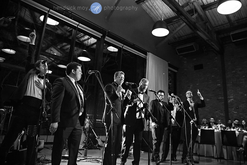 wedding photographer beacon ny roundhouse groomsmen singing reception moments